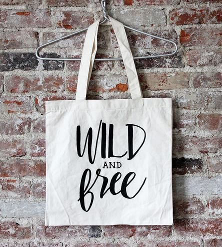 This phrase keeps appearing in my life and I'm so glad. Love it! :: Wild & Free Canvas Tote Bag by The Oyster's Pearl