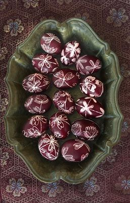Easter Eggs decorated in the Grevena, Greece. Boiled eggs are used to first design the motifs on them with melted candle and then they are painted in traditional red which leaves the candle area to reveal the motif as you see in the photo. You will need old plain candle, pen to dip in it and somethin to keep the candle warm.