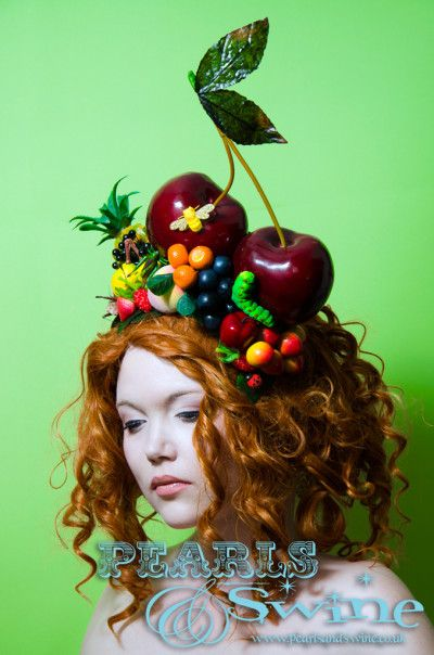 Carmen – Giant Cherry Fruit Headdress, Carmen Miranda, Tutti Frutti, Pineapple, Grapes, Oranges, Peaches, Apple, Insects, Bees, Caterpillar, Sinamay Base, Headband, Royal Ascot, Kentucky Derby, Ladies Day, Races, Statement Piece, Fashion, Wearable Art, Pop Surreal Millinery, Vibrant, Colourful, Exotic, Tropical, Hand Crafted, Flamboyant, Pearls and Swine, Pearls & Swine, Bespoke Milliner, British Designer, Hat Maker, Burlesque