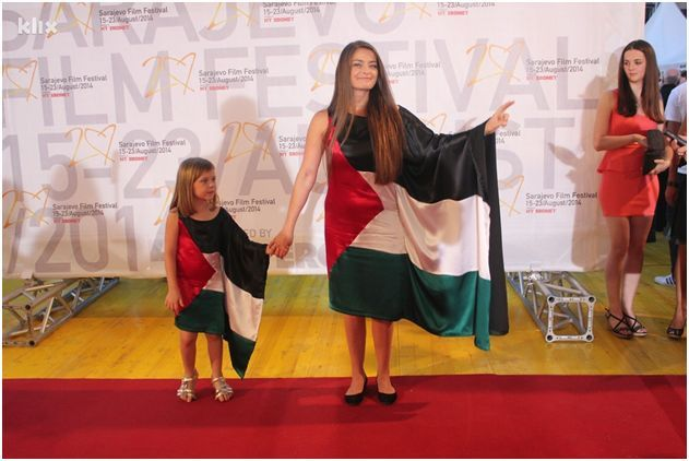 "Sabina Šabić and her daughter, Sara, in the ""flag gowns"" at the Sarajevo Film Festival red carpet, August 2014. Photo by Davorin Sekulić/kli..."