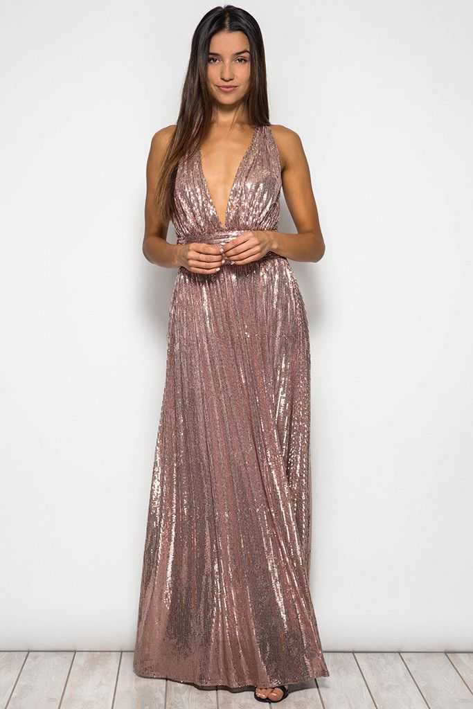 Drop dead gorgeous! The Low Cut Rose Gold Sequin Maxi Dress is a plunging v-neckline with a fitted cinched waistline that secures in the back with a row of hook and eye closures. The open criss cross