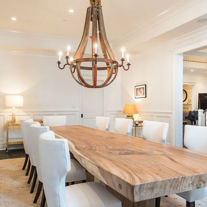 Natural wood dining room table, a touch of industrial chic in the chandelier, with classic, upholstered dining chairs