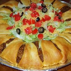 used to be a favorite dinner around here! The Taco Ring! 4 main ingredients and the rest is up to you ;)