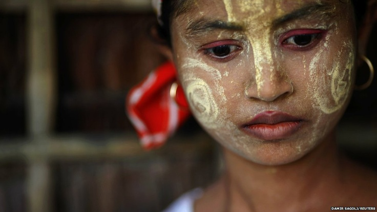A Myanmar Rohingya girl wears traditional make-up at the village of Takebi north of the town of Sittwe
