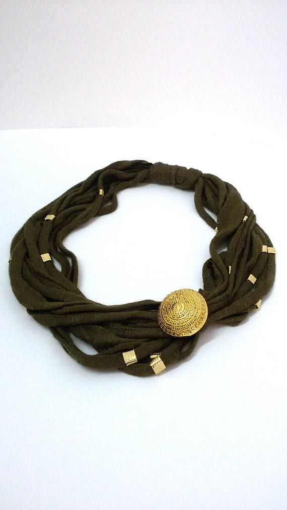 Fabric necklace dark green with gold metal applications and a