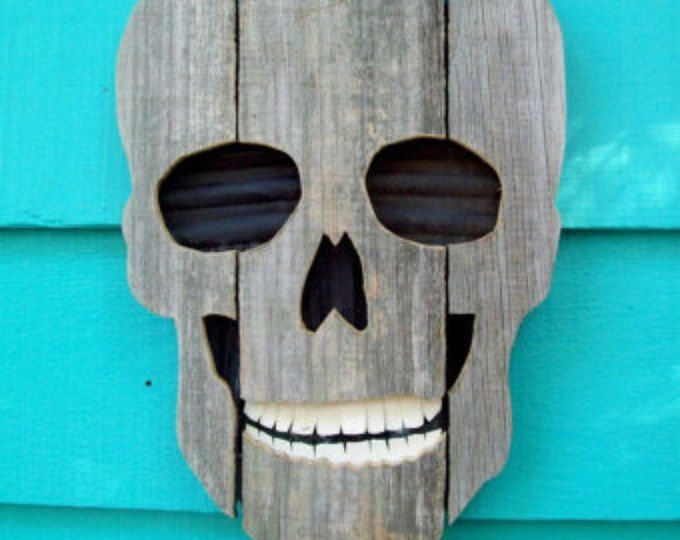 Skull made of recycled wood and plastic, upcycled fence wood