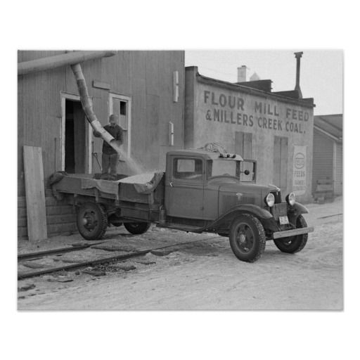 Grain Delivery Truck, 1936. A worker loads a delivery of corn onto a truck from a grain elevator. Spencer, Iowa.