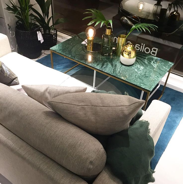 Love this light grey sofa and green marble table i…