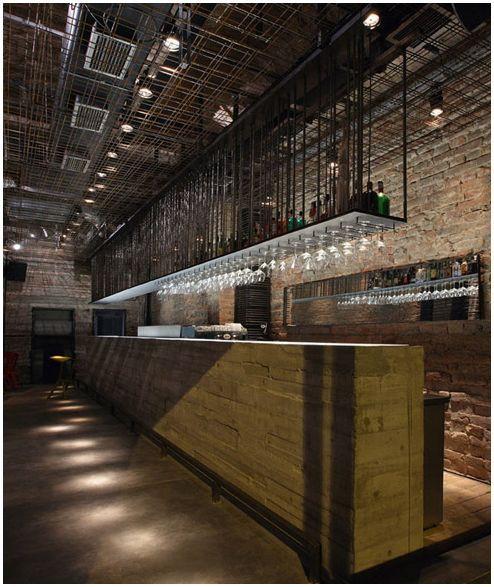 Glass racks, tall ceiling, lighting, mood, bar, exposed brick - KB