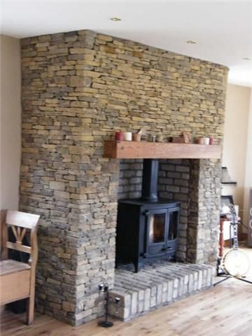 Dry stone shale fireplace with raised reclaimed brick fire-heart.: Are ...