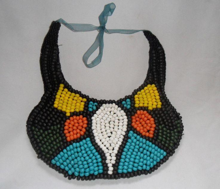 Colar todo bordado em miçangas coloridas. Acabamento com miçanguinhas pretas e fita de organza.