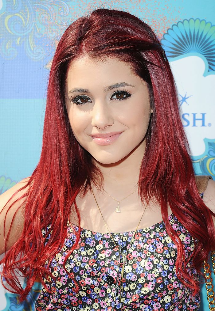 In 2010, Ariana Grande debuts long, purple tinted strands with long lashes and glossy lips