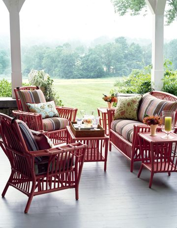 Eddie Ross used Dash and Albert rugs on this vintage rattan he painted hot coral