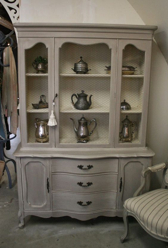 French Provincial China cabinet painted with ASCP's Cocoa and Old Orche wash.. Inside of cabinet is Old Orche..