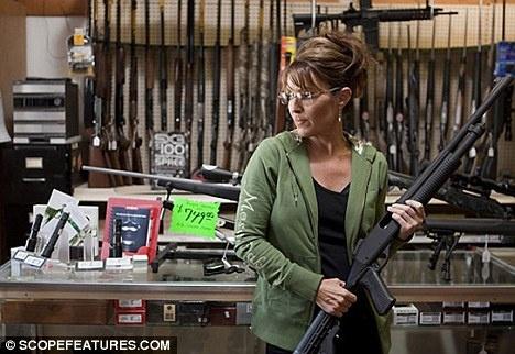 Sarah and a gun.