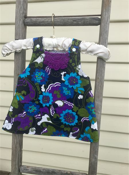 Funky reversible pinafore dress. Size 6-12 mths