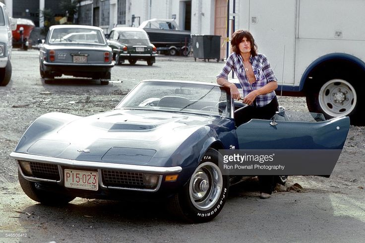 Aerosmith guitarist Joe Perry poses for a portrait with his 1975 Corvette Stingray on August 10, 1975 in Waltham, Massachusetts.