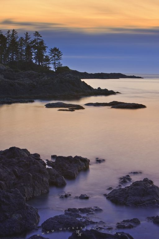 the rocky Pacific coastline and scenery of South Beach at sunset, Vancouver Island, Canada.
