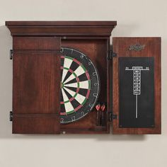 Features:  -Door material: Solid Wood on the front.  -Cabinet material: MDF with veneer.  -Finish: Sierra.  Product Type: -Dartboard and Cabinet Set.  Darts Included: -Yes.  Scoreboard Included: -Yes.