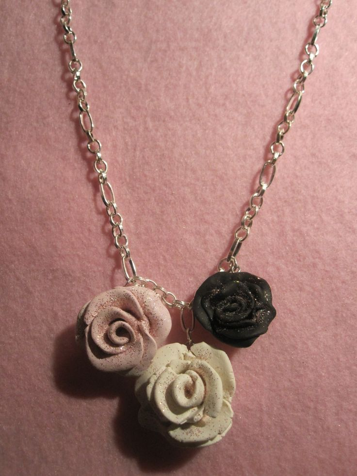 Necklaces - Kuku Bat One of my initial ventures into entrepreneurship in the 7th grade! :) #polymerclay #handmade #diy #kawaii #charms #cute #adorable #rose #pink #black #white #sparkly #necklace