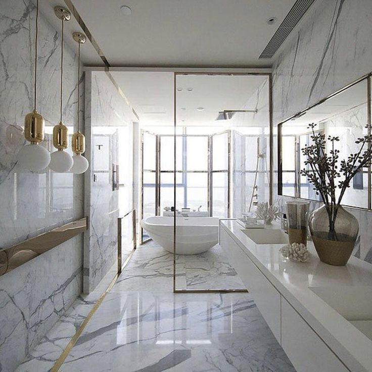 This bathroom is such a glamorous inspiration! Here, Kelly Hoppen combined marble with gold tones in small details, such as the pendants. ➤To see more Luxury Bathroom ideas visit us at www.luxurybathrooms.eu #luxurybathrooms #homedecorideas #bathroomideas @BathroomsLuxury