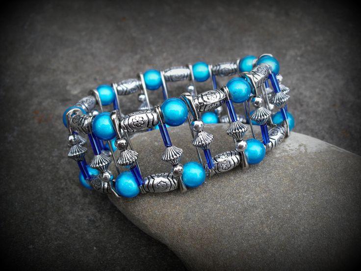 Wonder bead Safety pin bracelet. Elastic/stretch pin bracelet with blue/silver beads.. $12.50, via Etsy.
