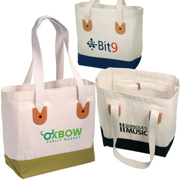 """Cape Cod Tote.  12 oz. natural cotton tote with contrasting bottom.  Leather patch handle anchors.  Internal zippered pocket.  16-1/2""""w x 12""""h x 5""""d with 25-3/4"""" handles.  This item is not CPSIA compliant."""