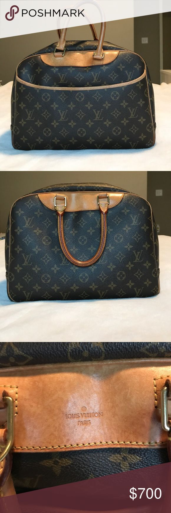 Authentic Louis Vuitton purse Authentic Louis Vuitton cross body/hand bag. Bag very well taken care of. Missing the straps to use as a cross body bag. The only smudge/scratch marks are in the photos. The zipper is a little warn down. I think it is a little too heavy for me. Looking to trade for authentic MK purse or watch. I'll also take for the price given or offered. Louis Vuitton Bags