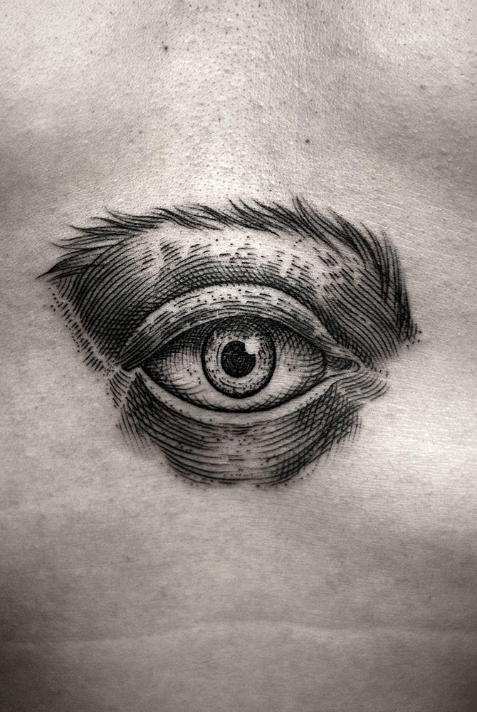 black woodcut style eye tattoo by Kamil Czapiga
