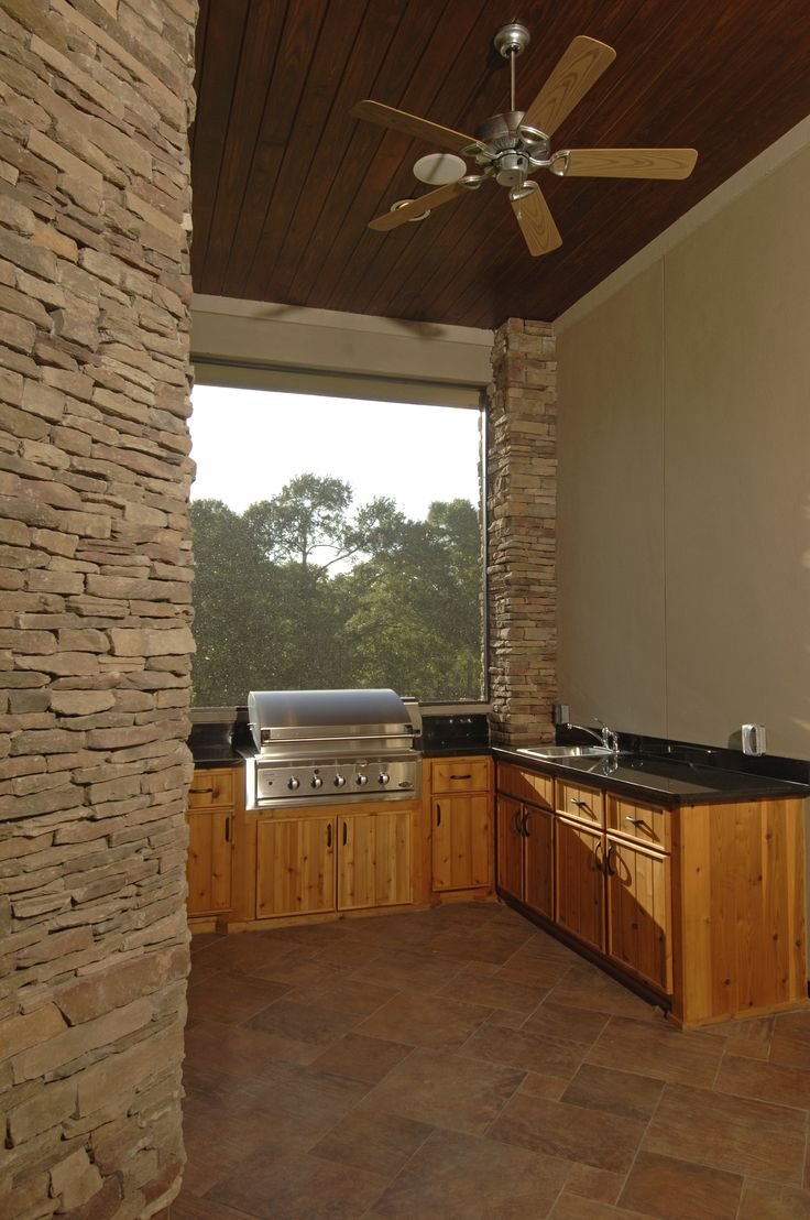 Outdoor Kitchen with wood by Increte of Houston
