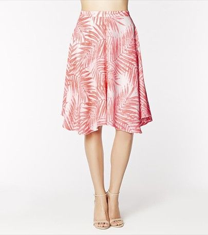 Opt for this feminine  refreshing new length! Pair this coral midi skirt with your fave cropped top!