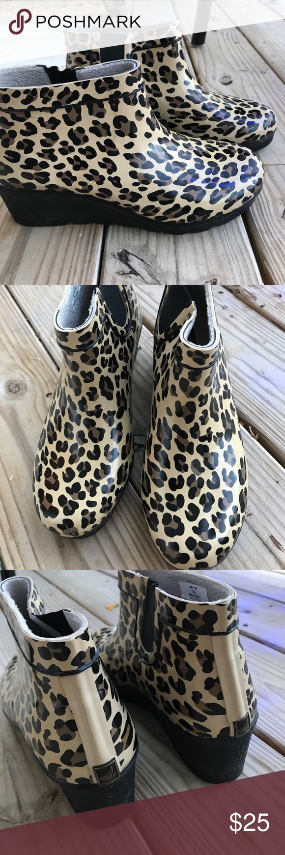 Sperry Waterproof Wedge Rain Ankle Boots In like new condition. Rubber soled, waterproof boot with 2 inch wedge heel and leopard print. Soft insulated lining. Slip on with elastic stretch band. Sperry Top-Sider Shoes Winter & Rain Boots