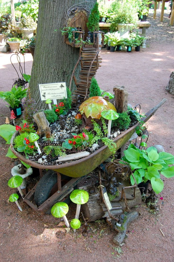 Perfect Idea For That Worn Out Wheel Barrel. A Beautiful Fairy Garden Home.