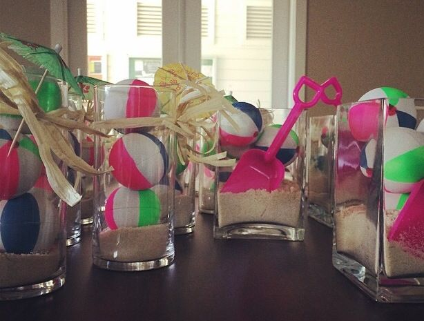 Beach Themed Party Center Pieces- how cute are these? Mini beach balls, sand, shovels, & raffia. Love it!!!!!!!!   Beach Bash Theme Party, Beach Party, Beach Centerpiece, summer fun centerpiece, pool party centerpiece, mini beach ball center piece
