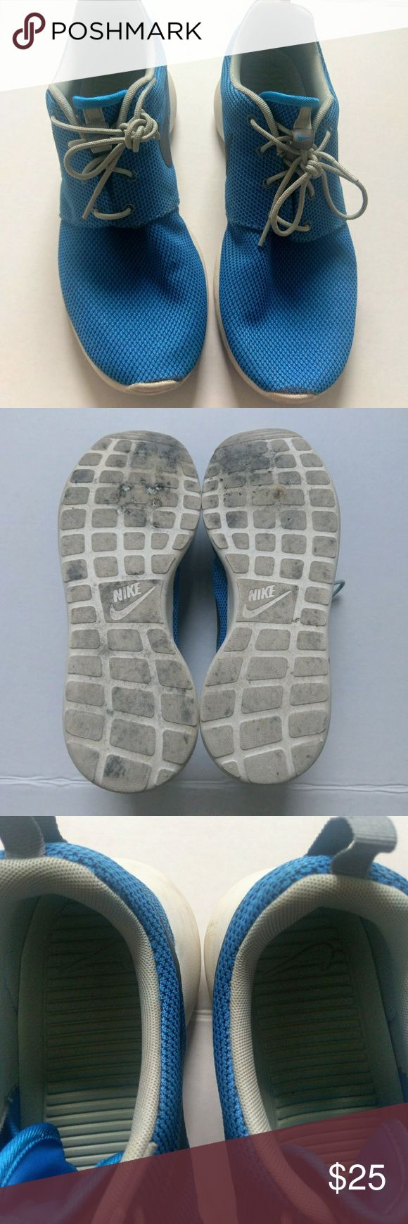 Nike men's Roshe sneaker size 12 Only worn a few times. Please see pics for sign of wear. Mainly small scuffs some wear on the sole. Nike Shoes Sneakers