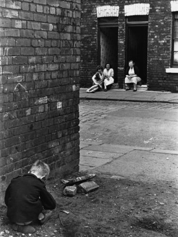 © Shirley Baker  Boy Playing in the Street - Salford, Manchester 1964