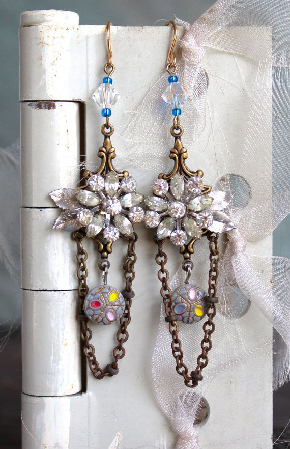 Such an interesting combination of vintage rhinestone earring parts on a victorian style brass base, adorned with an antique glass button and a swarovski crystal bead. Lengths of vintage chain add a finishing touch. A little bit dress-up, but still OK for everyday wear. The length from the top of the earwire to the bottom of the chain is 3. OldNouveau and MountainLaurel offer a distinctive line of antique button jewelry. Other offerings include jewelry made from Typewriter keys, antique…