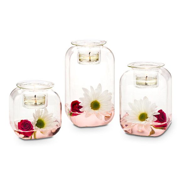 "Clearly Creative™ Classic Votive Trio  Item #:  P92264 Classic shape gives this blown glass trio a retro look. Fill with what you love then top with votive or tealight candles, sold separately. One holder in each height: 6¼""h, 5""h, 3½""h."
