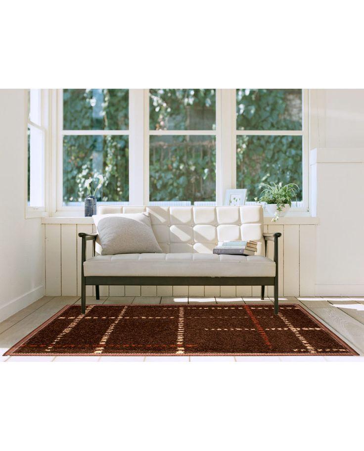 Moderna alfombra con estampado geométrico en varios colores sobre fondo marrón y pelo corto. Renueva la decoración de tu hogar al mejor precio en Revitex online