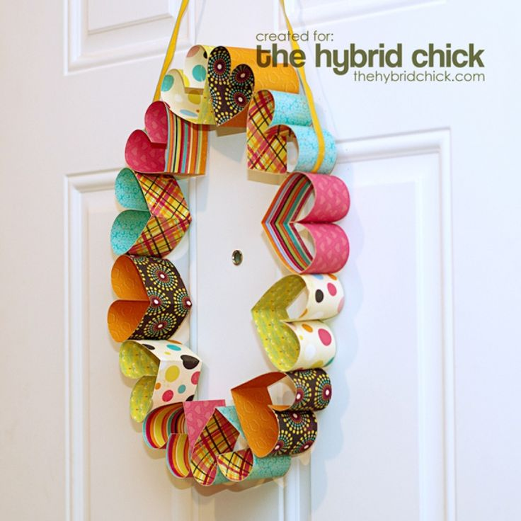 Heart garland wreath. So cute! Would be awesome to use double sided scrapbook paper!