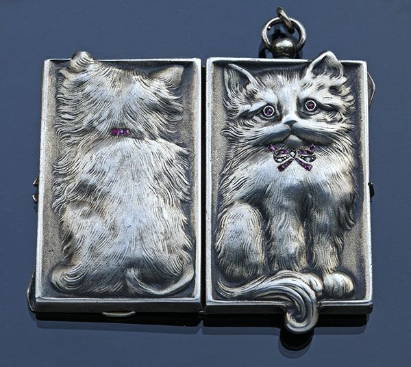 ART NOUVEAU  Cat Locket   Silver Ruby Diamond  H: 6.2 cm (2.44 in)  W: 1.5 cm (0.59 in)  L: 3.2 cm (1.26 in)   Marks: 900'  German, c.1900  Fitted Case