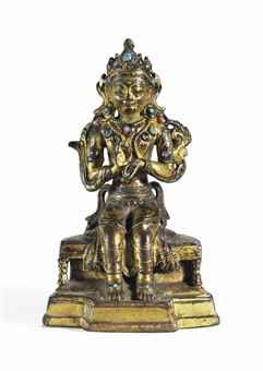 A Gilt Bronze Figure of a Seated Maitreya Nepal, 16th/17th century inlaid with hardstones, the base sealed and incised with a double-vajra 4 ¾ in. (12 cm.) high