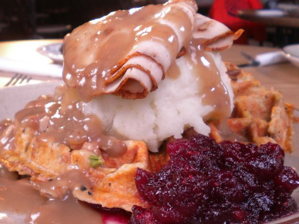 "Funk 'N Waffles : ""They make the stuffing that makes the waffle,"" Guy Fieri says of the base of the Jive Turkey Waffle, a Thanksgiving-inspired waffle, from Funk 'b Waffls in Syracuse, N.Y. This piled-high plates features not only the rosemary-laced stuffing waffle, but also all of the traditional turkey day fixings, like mashed potatoes, roast turkey and rich gravy. According to Guy, this ""hits you like a holiday."""