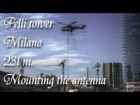 Unicredit Tower montaggio dello spire (antenna) con elicottero super puma. Spettacolare.