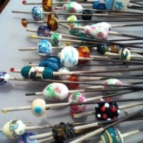 Find wonderful handmade glass beads for sale or join in a bead making class at the Torch an Marver.