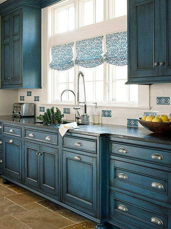 Bright and Blue...what do you think? It would match your stove....and would be way cheaper to paint existing cabinets than to replace them...and would make the yellow pop in the next room