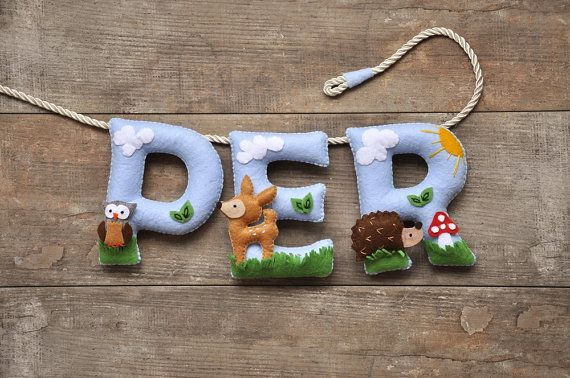 A Woodland animals themed, personalised felt name banner, made of different…