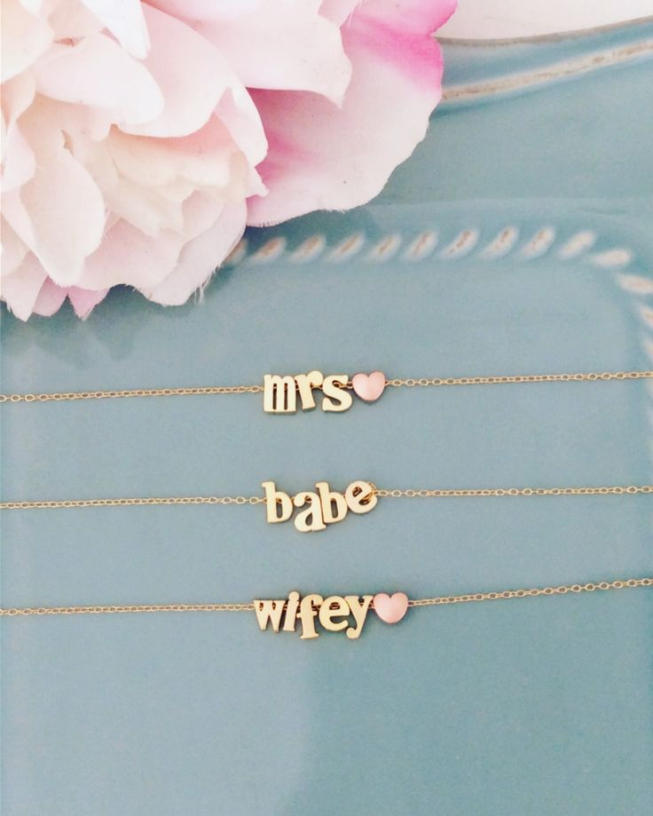 Great way to show he put a ring on it :) Choose from mrs, babe or wifey. Perfect bridal shower gift idea. See more here: https://www.etsy.com/listing/501198856/personalized-gift-name-necklace-gold