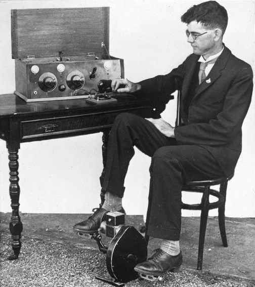 """PEDAL POWER The Flying Doctor Service and the School of the Air both relied on radio powered by a pedal generator invented in 1928 by Alfred Traeger, shown above with his first working prototype. It continued in use until late in the century when the """"Traeger"""" was replaced by diesel generators and, more recently, solar power."""