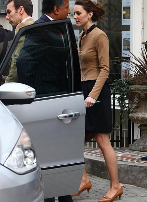 Duchess Catherine in black Issa wrap dress, tan Salvatore Ferragamo kitten heels, and camel-colored Whistles jacket doing some pre-wedding shopping on King's Road, April 2011